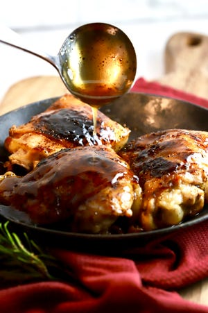 Honey baked chicken thighs are pan-seared and then baked in the oven in a sweet and savory glaze made with honey and apple cider vinegar.