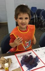 August Siena, 3, of Dividing Creek enjoys painting during a Wee Read session at the Cumberland County Library.