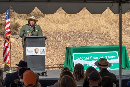 Joy Kinard, Superintendent at the Charles Young Buffalo Soldiers Monument, speaks during a ceremony to dedicate a stretch of Highway 198 just outside the park to Colonel Charles Young on Monday, November 11, 2019 . About 100 gathered near the Foothill Visitor Center as speakers recounted the legacy of the former superintendent. He was instrumental in creating the first wagon trails into the park.
