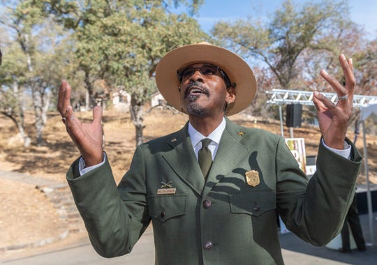 Yosemite National Park Ranger Shelton Johnson talks about the significant contributions of Colonel Charles Young on Monday, November 11, 2019 during a ceremony to dedicate a stretch of Highway 198 just outside the park in his name. About 100 gathered near the Foothill Visitor Center as speakers recounted the legacy of the former superintendent. He was instrumental in creating the first wagon trails into the park.