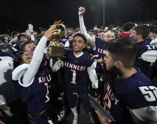 Kennedy Catholic players celebrate winning the CHSFL 'A' division championship game at Kennedy Nov. 10, 2019. Kennedy beat Cardinal Spellman 39-33 in OT.