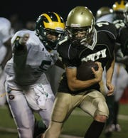 Clarkstown South quarterback Tommy McGuire (right) during a 2010 game against Ramapo.