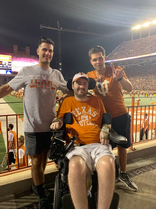Tommy McGuire (center) recently took his first plane ride since 2016. He is seen here with his father, Tom and uncle, Mark, during the trip to Austin, Texas, to visit his friends Tamir Sobel and Johnny Naclerio and attend a University of Texas football game.
