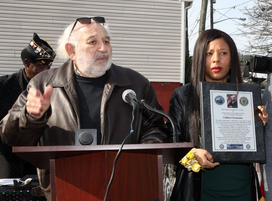 Carline Gordon receives a plaque from Spring Valley Mayor Alan Simon during ceremony to honor her brother, US Navy Seaman Gilbert Fontaine, the first Rockland military service member killed in Desert Storm in Spring Valley Nov. 11, 2019.