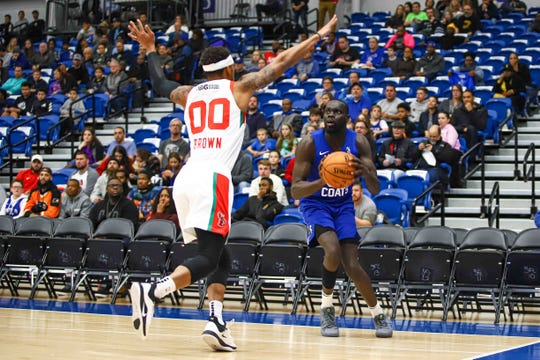 Maine Red Claws guard Bryce Brown (00) defends Delaware Blue Coats guard Marial Shayok (35) on Saturday, Nov. 09, 2019, at the 76ers Fieldhouse in Wilmington, DE.
