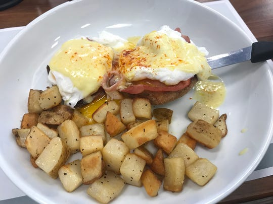 Eggs Benedict at Turning Point is a classic rendering of the dish, except the kitchen uses sliced Virginia ham instead of Canadian ham and adds sliced tomato.