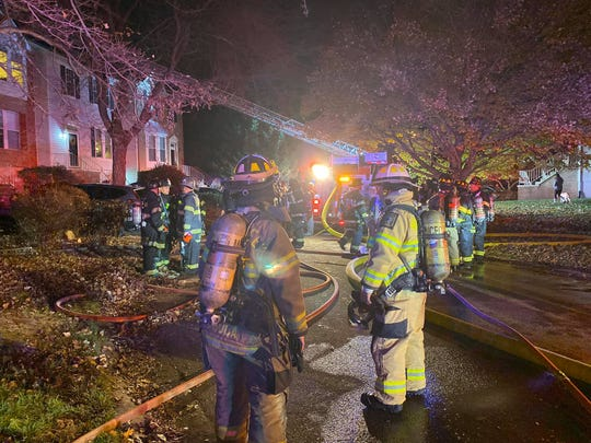 A Sunday night fire that began when sparks flew out of a first floor fireplace in a Pike Creek townhouse caused significant damage, the state fire marshal's office said.