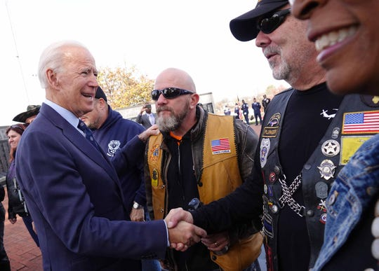 Former Vice President Joe Biden embraces veterans at the annual Veterans Day service at Delaware Memorial Bridge Veterans Memorial Park on Monday morning.