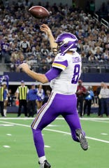 Minnesota Vikings' quarterback Kirk Cousions throws a touchdown pass against the Dallas Cowboys defense Sunday, Nov. 10, 2019, at AT&T Stadium in Arlington. The Vikings defeated the Cowboys 28-24.