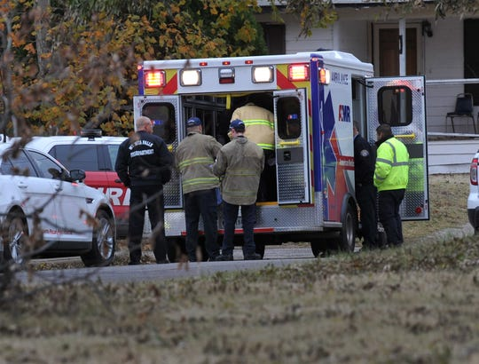 Emergency medical technicians work to transport a gunshot victim Monday afternoon in the 600 block of Roosevelt St.