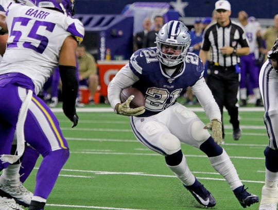 Dallas Cowboys' Ezekiel Elliot runs through a hole against the Minnesota Vikings Sunday, Nov. 10, 2019, at AT&T Stadium in Arlington. The Vikings defeated the Cowboys 28-24.