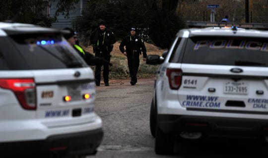 Wichita Falls police work to secure the scene of a possible shooting, Monday afternoon in the 600 block of Roosevelt St.