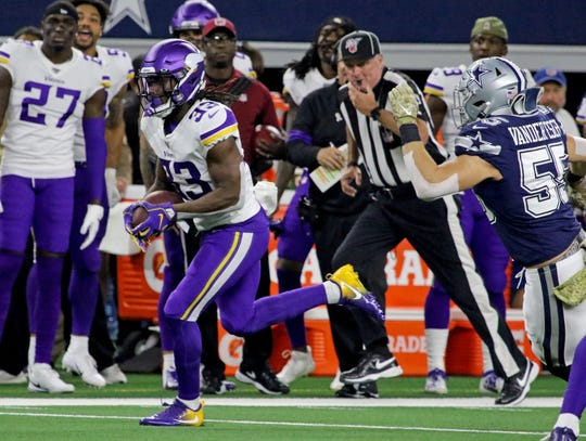 Minnesota Vikings' Dalvin Cook runs for a first down against the Dallas Cowboys Sunday, Nov. 10, 2019, at AT&T Stadium in Arlington. The Vikings defeated the Cowboys 28-24.