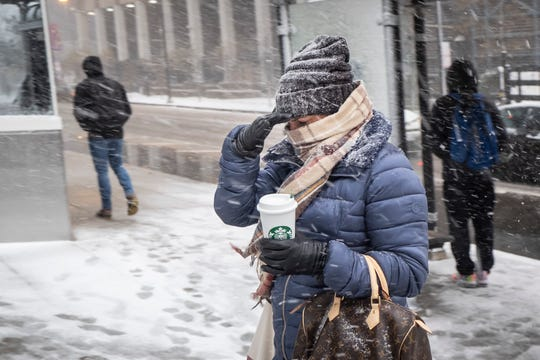 Commuters stroll in the snow as a cold weather weather advisory is issued for the Chicago rental on Monday, Nov. 11, 2019, in Chicago