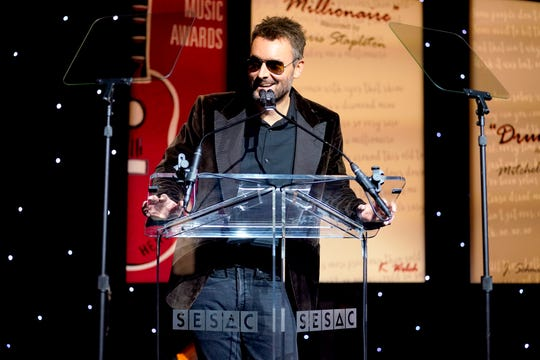 Eric Church speaks onstage during the 2019 SESAC Nashville Music Awards.