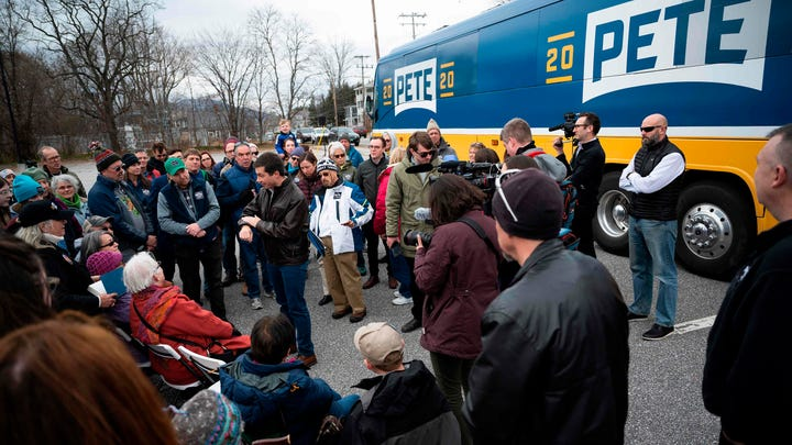 Democratic presidential hopeful Pete Buttigieg speaks with supporters prior to a canvassing Kick-Off in Claremont, NH, on November 10, 2019.