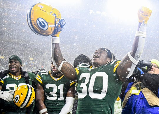 Green Bay Packers running back Jamaal Williams (30) celebrates after the Packers defeated the Carolina Panthers at Lambeau Field.