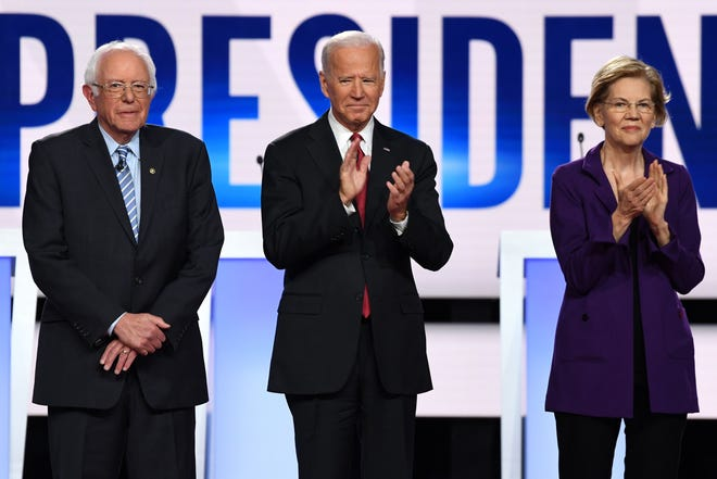 From left: Democratic presidential hopefuls Vermont Senator Bernie Sanders, former United States Vice President Joe Biden and Massachusetts Senator Elizabeth Warren arrive onstage for the fourth Democratic primary debate of the 2020 presidential campaign season co-hosted by The New York Times and CNN at Otterbein University in Westerville, Ohio, on Oct. 15, 2019.