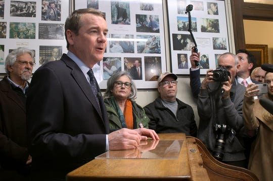 In this Nov. 6, 2019, photo, Democratic presidential candidate Sen. Michael Bennet, D-Colo., stands in the New Hampshire secretary of state's office in Concord, N.H., after filing to be on the state's first-in-the-nation presidential primary ballot. (AP Photo/Holly Ramer)