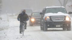 William Immekus, of Fox Point, rides his bike to work through the snow down Santa Monica Blvd.? in Fox Point on Monday, Nov. 11, 2019. Snow began falling overnight and is expected to continue through much of Monday morning, bringing 3 to 4 inches of snow to metro Milwaukee and 4 to 6 inches in Racine and Kenosha counties.