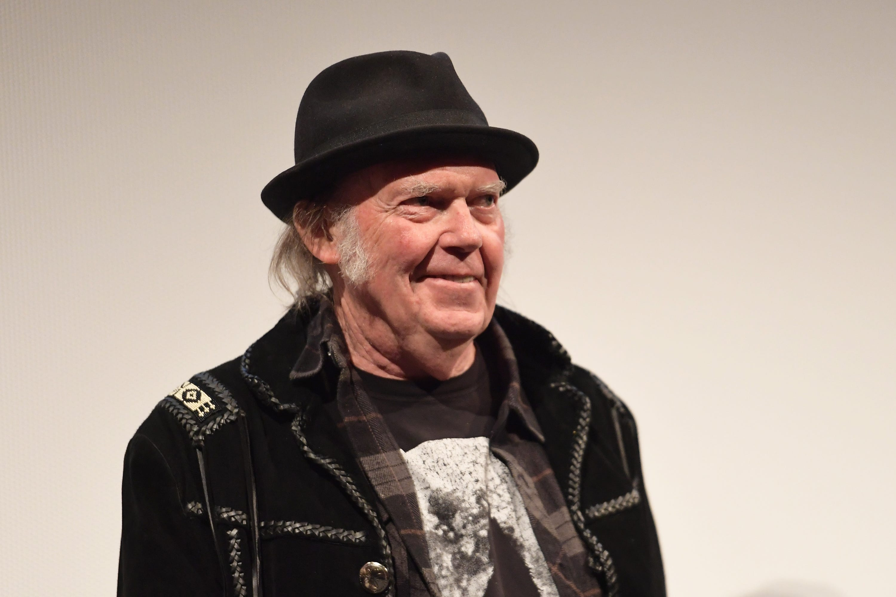 Neil Young says President Trump is  a disgrace to my country  in scathing open letter
