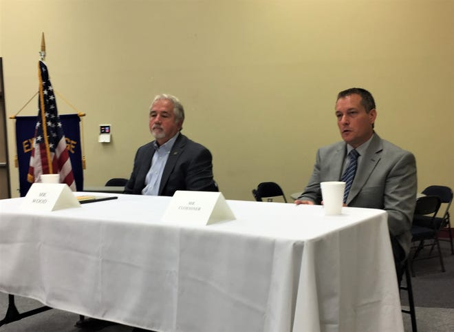 Candidates for Rapides Parish Sheriff Mark Wood (left) and Kris Cloessner answer questions at an Alexandria Exchange Club forum last week.