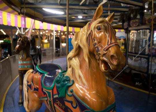 Workers from Carousels and Carvings of Marion, Ohio dismantle the Seaside Heights carousel to put it in storage before it is shipped away for refurbishing. Officials hope to have a new home for it to be reassembled when it has been restored.