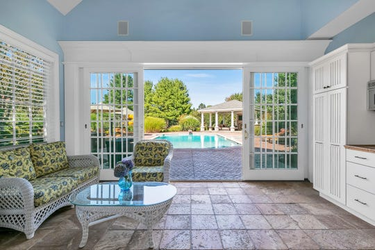 The estate offers a pool house with custom built-ins and tile flooring