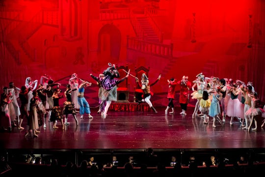 The Nutcracker battles the Rat King in Atlantic City Ballet's production.