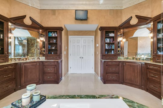 The Master bathroom features his and hers custom sinks