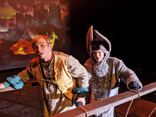 "Shrek (Wes Horn) and Donkey (Caleb Speights), cross a bridge over lava outside the castle where Princess Fiona awaits in this rehearsal scene from Wylie High School's ""Shrek: The Musical."""