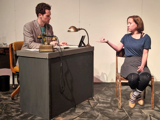 """Sophie Scholl (Carly Carroll), right, explains herself to investigator Robert Mohr (Griffin Jones) in this rehearsal scene from Abilene Christian University's upcoming production of """"The White Rose."""""""