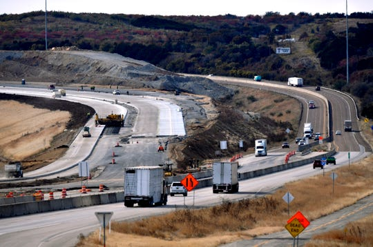 Vehicles travel east and west on Interstate 20 at Ranger Hill on Tuesday as construction crews continue building a newer road with a more gradual grade.
