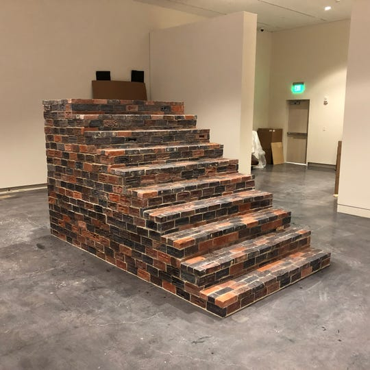 "Josh Copus used bricks created by Madison County students in his work, titled ""Threshold,"" that features inside the Asheville Art Museum."