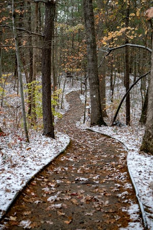 The sides of a trail are dusted with snow at the Folk Art Center on the Blue Ridge Parkway on Nov. 12, 2019.