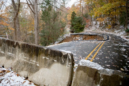 Concrete barriers stop vehicles from driving on Old Toll Road near Town Mountain Road on Nov. 12, 2019. A section of the road washed away in April.