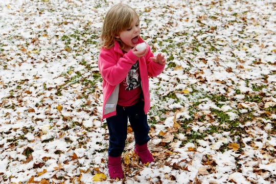 Paislee Causey, 4, eats a ball of snow in West Asheville November 12, 2019.