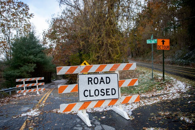A road closed sign sits at the entrance to Old Toll Road at Town Mountain Road on Nov. 12, 2019. A section of the road washed away in April.