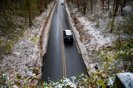 Cars drive on Riceville Road after a dusting of snow on Nov. 12, 2019.