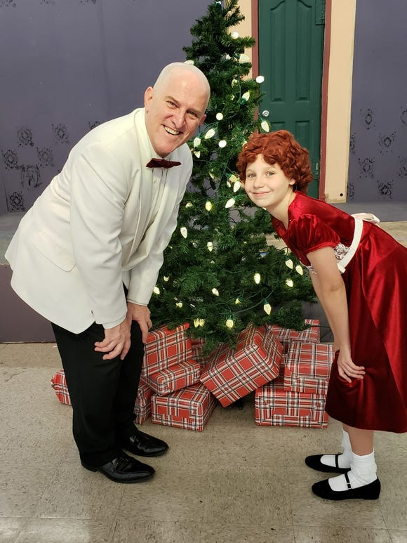 Daddy Warbucks (Jeffrey Bassett) and Annie (Zoe Cook) are back on the Paradise Theatre stage for the third time in the current decade.