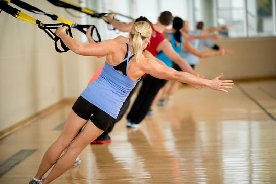 TRX traininguses suspension exercises to help athletes such as tennis players increase durability, flexibility and strength.