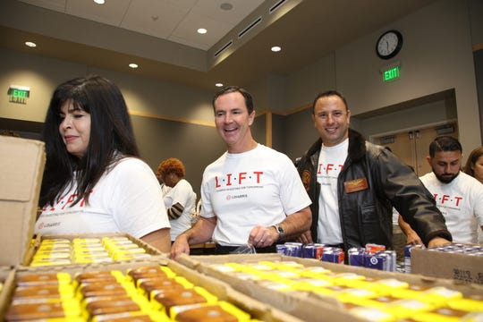 About 500 local employees of L3Harris Technologies Inc. packed 7,000 food kits for the Second Harvest Food Bank on Veterans Day. Among the participants were, from left, retired Army Spc. Tanya Earwood; L3Harris Chairman and Chief Executive Officer Bill Brown; and retired Marine Corps Lt. Col. Delta Burke.
