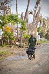 Treasure Cay resident hauling debris.  October 23, 2019.
