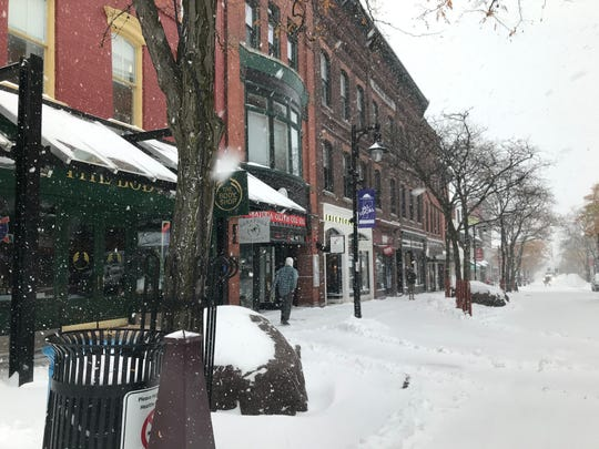 Snow falls on Church Street in downtown Burlington 9 a.m. on Nov. 12.