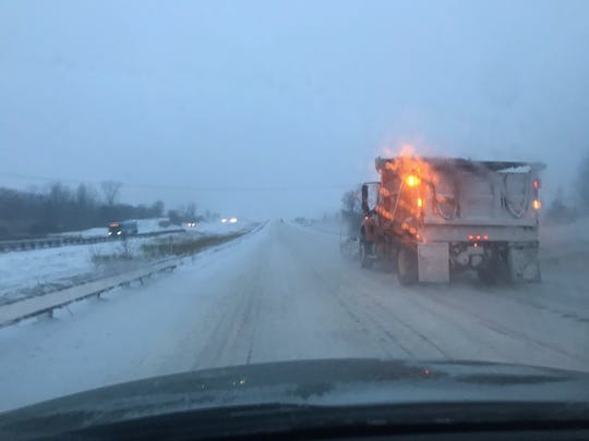 A Vermont Agency of of Transportation plow truck clears snow on Interstate 89 North in Williston on the morning of Nov. 12, 2019.