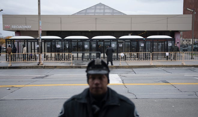Police officers patrol outside of the Walter Rand Transportation Center in Camden on Tuesday, November 12, 2019.  The Camden County Police Metro Division are working with NJ Transit Police and DRPA to clear the area of undesirable activities.