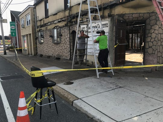 A bar stool holds caution tape during renovations to the former Guiseppi's Restaurant in Mount Ephraim.