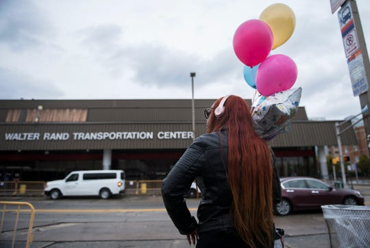 Tanika Erwin of Lindenwold waits for a bus at the Walter Rand Transportation Center in Camden on Tuesday, November 12, 2019.  Erwin stated that she has noticed an improvement at the transportation center after the Camden County Police Metro Division began working with NJ Transit Police and DRPA to clear the area of undesirable activities.