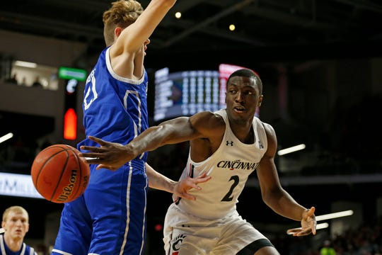 Cincinnati Bearcats guard Keith Williams (2) throws a pass under the basket in the first half of the NCAA basketball game between the Cincinnati Bearcats and the Drake Bulldogs at Fifth Third Arena in Cincinnati on Monday, Nov. 11, 2019. The Bearcats led 44-23 at halftime.