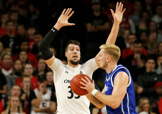 Cincinnati Bearcats center Jaume Sorolla (35) guards Drake Bulldogs forward Antonio Pilipovic (11) in the first half of the NCAA basketball game between the Cincinnati Bearcats and the Drake Bulldogs at Fifth Third Arena in Cincinnati on Monday, Nov. 11, 2019. The Bearcats led 44-23 at halftime.